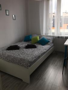 A bed or beds in a room at Apartment J&B