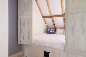 Een bed of bedden in een kamer bij B&B Spoelhof