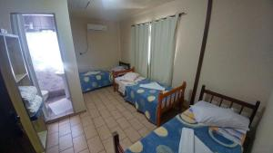 A bed or beds in a room at Hotel Ilhota