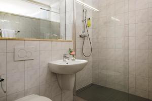 Ein Badezimmer in der Unterkunft Hotel Parc Belle-Vue