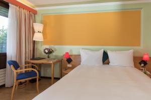 Ein Bett oder Betten in einem Zimmer der Unterkunft Hotel Parc Belle-Vue