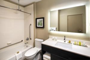 A bathroom at The Hollis Halifax - a DoubleTree Suites by Hilton