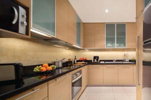 A kitchen or kitchenette at Oakwood Premier Cozmo Jakarta