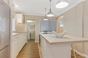 A kitchen or kitchenette at Hamptons at The Bay