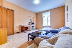 Гостиная зона в Longo Apartment Griboedova 9