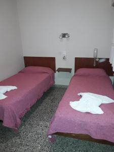 A bed or beds in a room at Hotel Mirasol