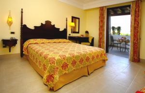 Кровать или кровати в номере Arciduca Grand Hotel