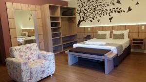 Cama ou camas em um quarto em Pousada Vitalis
