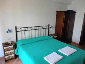 Letto o letti in una camera di Bed and Breakfast Ichnos