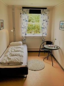 A bed or beds in a room at Hällefors Vandrarhem-Hostel & Kanotcenter