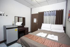 A bed or beds in a room at Zzhouse