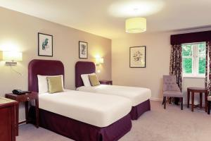 A bed or beds in a room at Mercure Thame Lambert Hotel