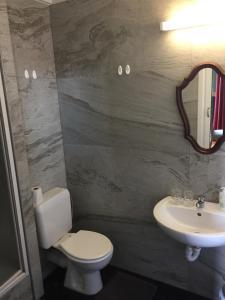 Een badkamer bij Vakantielogies Faja lobi