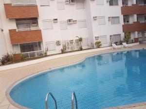 The swimming pool at or close to Apto de 02 qtos no Ingleses - Florianopolis - SC