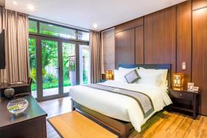 Un ou plusieurs lits dans un hébergement de l'établissement Dai An Phu Villa
