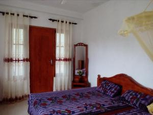 A bed or beds in a room at House Of Esanya