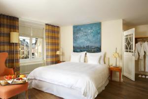 Ein Bett oder Betten in einem Zimmer der Unterkunft Hotel Parc Beaux Arts