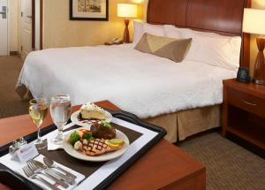 A bed or beds in a room at Hilton Garden Inn Las Cruces
