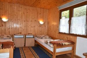 Łóżko lub łóżka w pokoju w obiekcie Camping Baltic