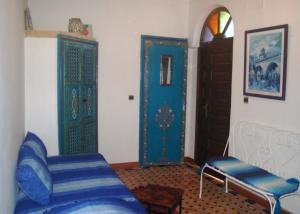 A bed or beds in a room at Riad Le Grand Large