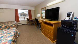 A television and/or entertainment center at BCMInns - Peace River