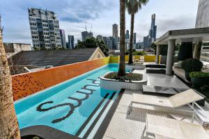 The swimming pool at or near Complete Host Domain Apartments