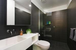A bathroom at Complete Host Domain Apartments