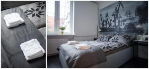 Łóżko lub łóżka w pokoju w obiekcie Chlebnicka 36