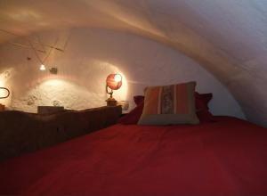 Un ou plusieurs lits dans un hébergement de l'établissement Le Domaine du Grand Cellier Gîtes Appartement en Savoie