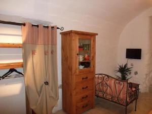 Télévision ou salle de divertissement dans l'établissement Le Domaine du Grand Cellier Gîtes Appartement en Savoie