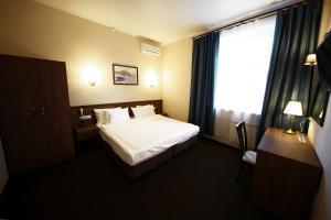 Кровать или кровати в номере Отель Проспект Мира