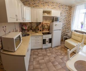 A kitchen or kitchenette at Apartment on Lenina 69А