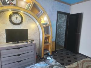 Телевизор и/или развлекательный центр в Дом для отдыха Анжела