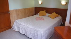 Een bed of bedden in een kamer bij Castillo Playa