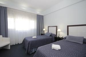 Una cama o camas en una habitación de Hotel Libertador de Pinamar