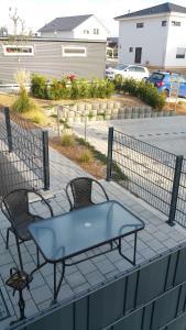 Ein Balkon oder eine Terrasse in der Unterkunft FeWo Brombachsee - Sonnentag West