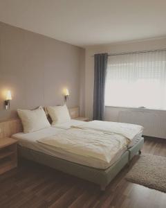 Ein Bett oder Betten in einem Zimmer der Unterkunft Hotel Ring Park