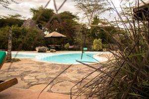 The swimming pool at or close to Ziwa Bush Lodge