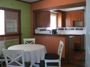 A kitchen or kitchenette at A White Jasmine Inn
