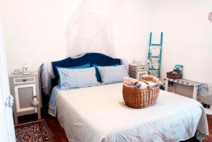 Letto o letti in una camera di Vistazzurra B&B