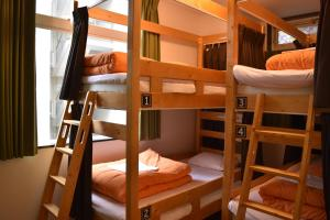 A bunk bed or bunk beds in a room at HopStepInn