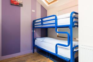 A bunk bed or bunk beds in a room at The Times Hostel - Camden Place