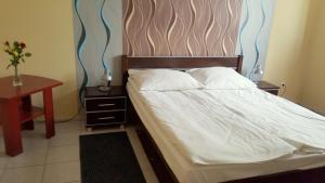 Postel nebo postele na pokoji v ubytování Hotel Ava