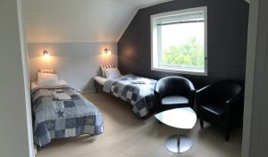 A bed or beds in a room at Lofoten Bed & Breakfast Reine - Rooms & Apartments
