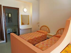 Letto o letti in una camera di Locazione Turistica Esmeraldo-5