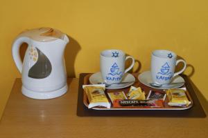 Příslušenství pro přípravu čaje a kávy v ubytování Penzion Kapitan