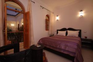 Un ou plusieurs lits dans un hébergement de l'établissement Riad Mariana