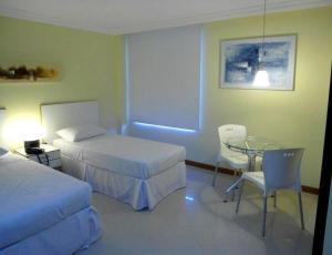 Cama ou camas em um quarto em Hotel Barra Mar