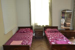 A bed or beds in a room at Picnic Hostel