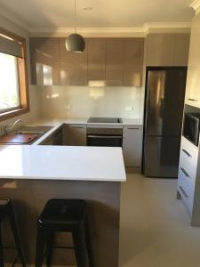 A kitchen or kitchenette at Ultiqa Village Resort